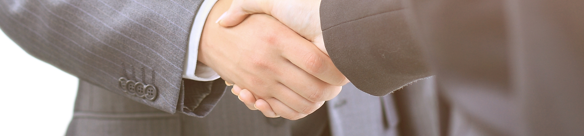 Handshake of the two businessmen, agreed in the contract.